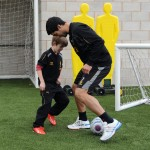 Luis and Finn have a kickabout