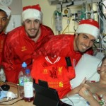 Reds players cheering up one youngster