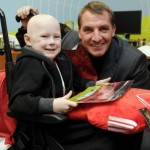 Manager Brendan Rodgers making one youngster smile